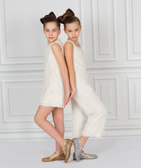 Two girls showing white tassel outfit and dress for kids