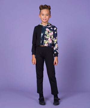Girl in high end navy blue track suit for kids with flower print by Mama Luma