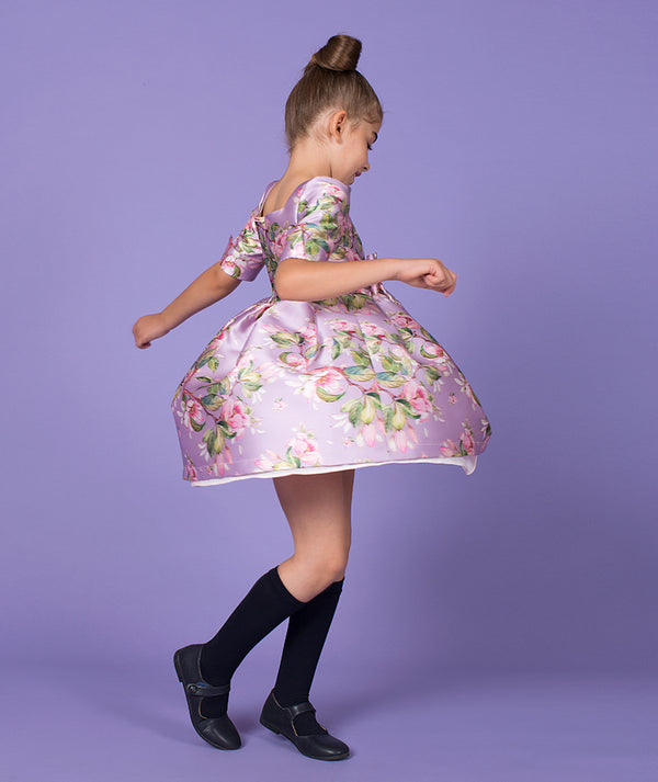 Girl twirling in a special occasion dress by Mama Luma