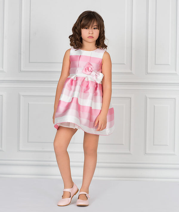Girl in striped pink and white party dress for kids