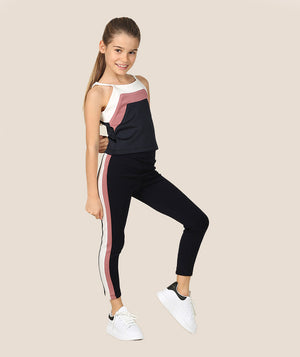 Girl in athleisure tracksuit for kids by Mama Luma