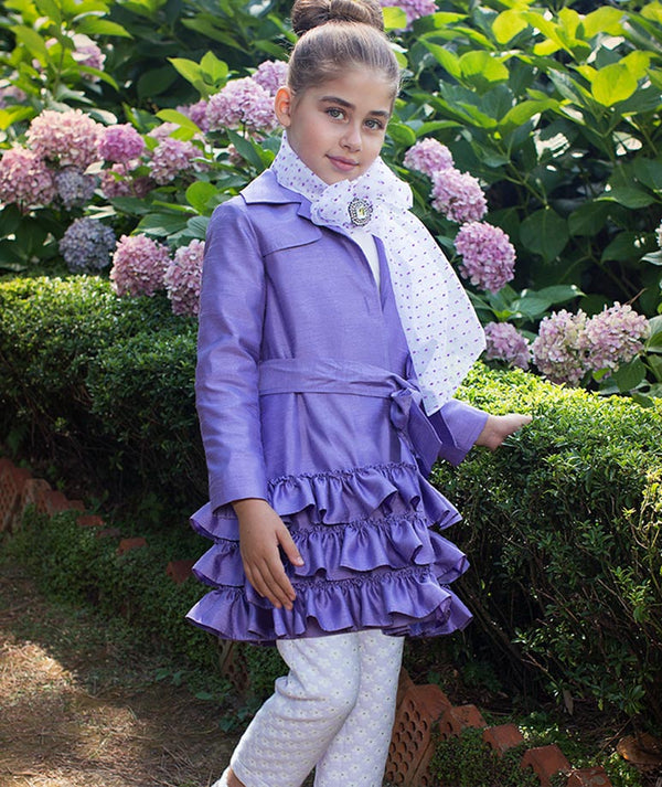 Girl in chic designer outfit for kids by Mama Luma in garden