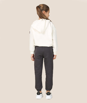 Girl in white athleisure jacket and gray sweatpants for kids by Mama Luma