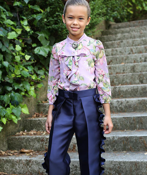 Girl in luxury blouse and pants for kids