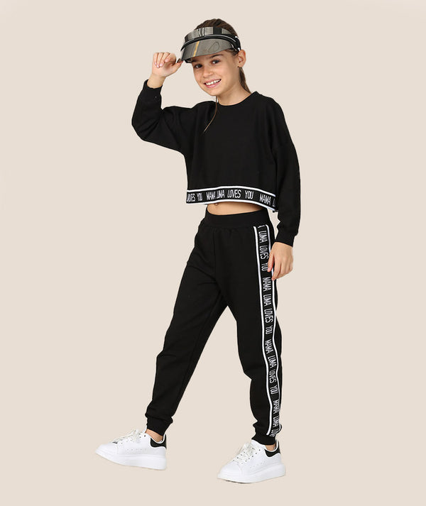 Girl in black athleisure outfit for girls