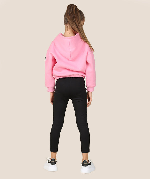 Girl in pink athleisure jacket for kids and black leggings for girls by Mama Luma