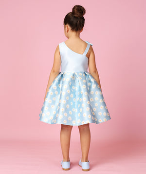 Back of girl in designer dress for kids with daisies