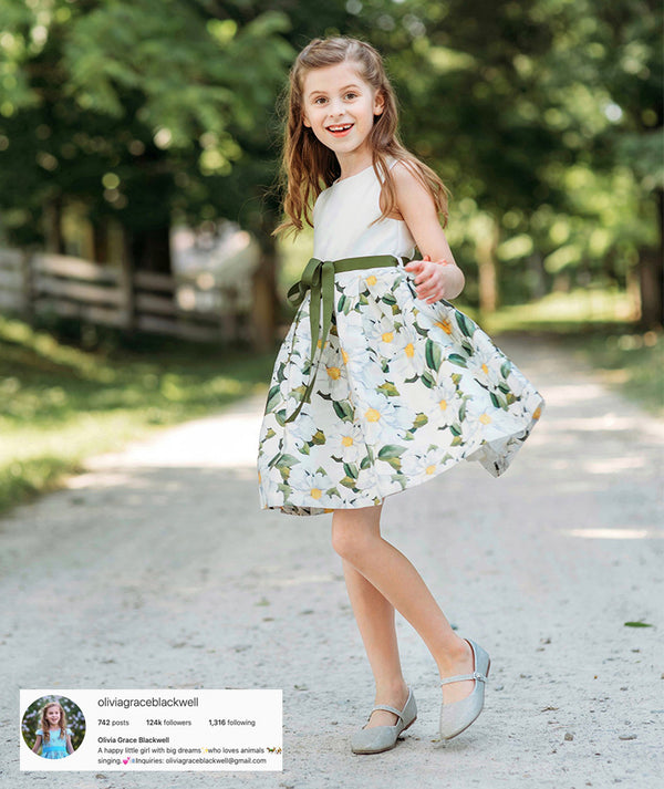 Olivia Grace Blackwell on forest road in daisy print dress for kids by Mama Luma