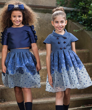 Girl in navy blue blouse and jacquard sheer skirt for kids and girl in chic navy blue dress for toddlers by Mama Luma