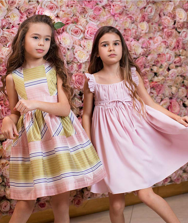Girl in striped designer kids dress and girl in pink ruffle cotton dress for kids