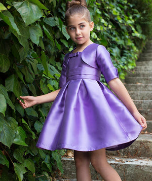 Girl in purple princess dress for kids by Mama Luma on staircase with vines