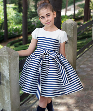 Girl in park with white and navy striped dress for girls by Mama Luma