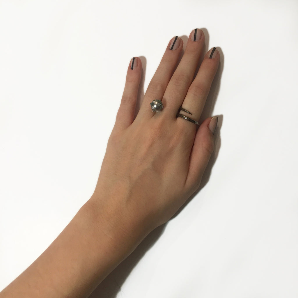 Wrap ring with floating spiked pearl