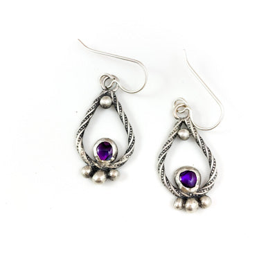 Mandana Studios sterling silver earrings twisted with purple abalone shell stone