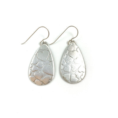 Mandana Studios cute sterling silver earrings with heart texture