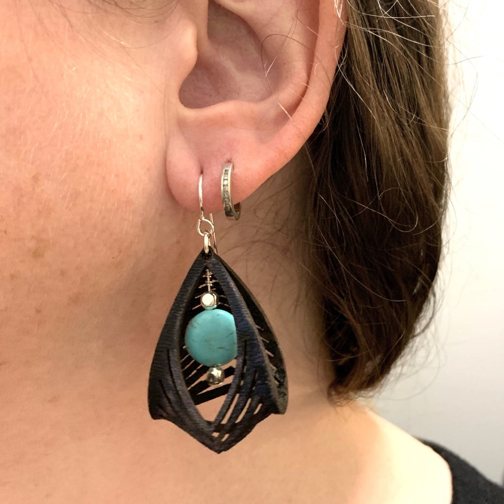 black leather cage earrings with howlite stone shown worn 2