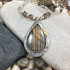 GOLDEN PEACH STRIPED LABRADORITE PENDANT
