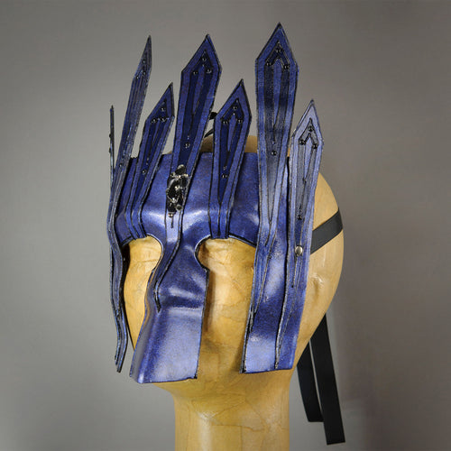 Black Diamond Midnight Blue Warrior Bauta Masquerade mask, with panel armor, metal findings and assorted polished gems. Inspired by medieval armor, this mask is particularly popular for men.  Handmade in the USA using traditional Venetian paper-mache technique. Lined with hypoallergenic stretch velvet for comfort. Side view.