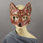 Fancy Red Fox Masquerade Mask. A lightweight comfortable mask inspired by the sly red fox, decorated with an elegant gold scroll motif and embellished with Swarovski Crystals and assorted gems.  Hand Made in the USA using traditional Venetian paper-mache techniques and lined with soft stretch velvet for comfort.