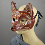 Fancy Red Fox Masquerade Mask. A lightweight comfortable mask inspired by the sly red fox, decorated with an elegant gold scroll motif and embellished with Swarovski Crystals and assorted gems.  Hand Made in the USA using traditional Venetian paper-mache techniques and lined with soft stretch velvet for comfort. Side view.