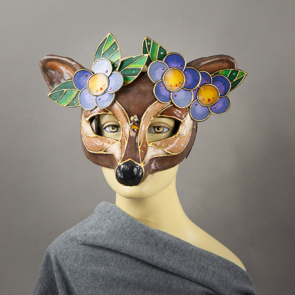 Deer Mask with paper-mache flowers, Swarovski crystals and assorted gems.