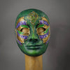 Green Steampunk Droid Mask. This unique piece is hand painted in shades of green and accented in purple and gold. Details include Swarovski Crystals, metal findings and assorted watch gears.  Handmade in the USA using the traditional Venetian paper mache process. Lined with soft stretch velvet for comfort.