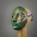 Green Steampunk Droid Mask. This unique piece is hand painted in shades of green and accented in purple and gold. Details include Swarovski Crystals, metal findings and assorted watch gears.  Handmade in the USA using the traditional Venetian paper mache process. Lined with soft stretch velvet for comfort. Side view.