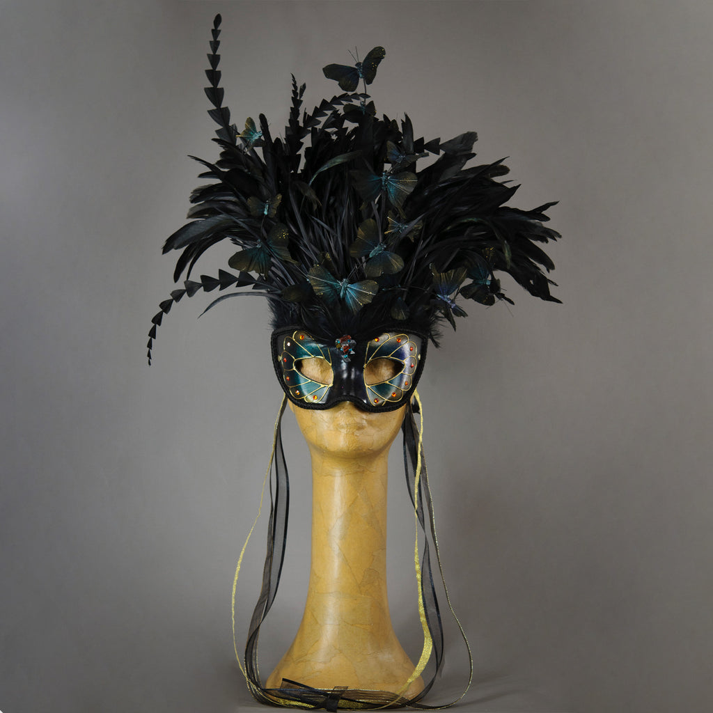 Beautiful Masquerade Mask, in iridescent shades over black. Crested with black coque feathers. Iridescent black feather butterflies flutter on the crest. Embellished with Swarovski crystals, and polished gemstones.  Hand made in the USA using traditional Venetian paper-mache technique. Lined with hypoallergenic stretch velvet for comfort.