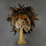 Stunning Lion Mask with a luxe crest of natural coque and assorted pheasant plumage. Embellished with Swarovski crystals, and assorted polished gem stones. Sure to turn heads at any costume, masquerade or Halloween party!  Hand-made in the USA using traditional Venetian paper-mache technique. Lined with hypoallergenic stretch velvet for comfort.