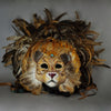 Stunning Lion Mask with a luxe crest of natural coque and assorted pheasant plumage. Embellished with Swarovski crystals, and assorted polished gem stones. Sure to turn heads at any costume, masquerade or Halloween party!  Hand-made in the USA using traditional Venetian paper-mache technique. Lined with hypoallergenic stretch velvet for comfort. Front view.