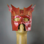 Bronze Warrior Bauta Masquerade mask, with panel armor, metal findings and assorted polished gems. Inspired by medieval armor, this mask is particularly popular for men.  Handmade in the USA using traditional Venetian paper-mache technique. Lined with hypoallergenic stretch velvet for comfort.