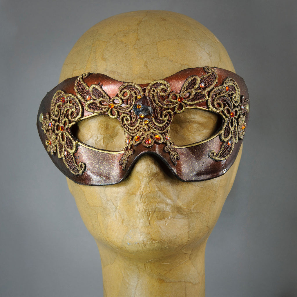 Metallic rust red lace mask with Swarovski crystals and assorted gems.