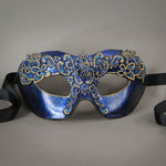 Simple, elegant eye mask in Metallic Sapphire Blue and Black with gold accents. Embellished with lacquered lace, glass gems, Swarovski crystals and polished stones.  Hand made in the USA using traditional Venetian paper-mache techniques. Lined in stretch velvet for comfort. Detail.