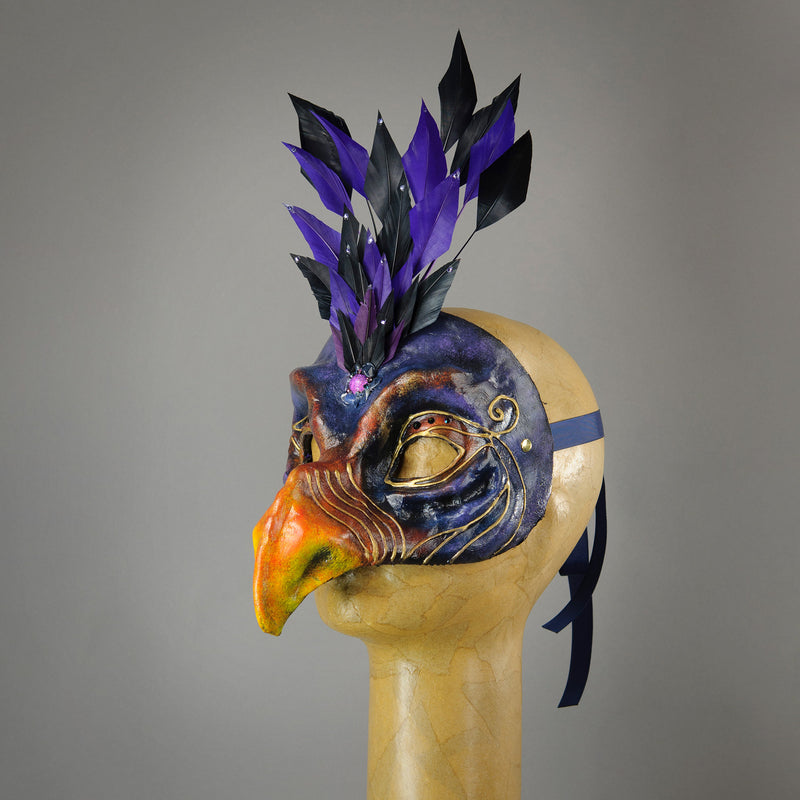 Skeksis inspired mask with diamond cut goose feathers and assorted gems. Side view.