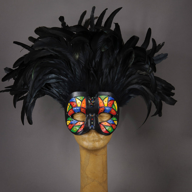 Beautiful Masquerade Mask, crested in Black coque feathers. Stained glass motif painted in rainbow colors and embellished with Swarovski crystals, dichroic glass and polished stones. Shades of red, orange, yellow, green and blue.  Hand made in the USA using traditional Venetian paper-mache technique. Lined with hypoallergenic stretch velvet for comfort.