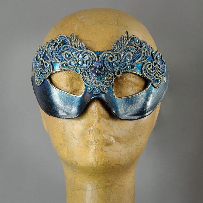 Simple, elegant eye mask in Metallic Turquoise Blue and Black. Embellished with lacquered lace, glass gems, Swarovski crystals and polished stones.  Hand made in the USA using traditional Venetian paper-mache techniques. Lined in stretch velvet for comfort.