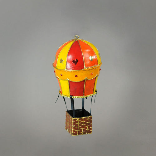 "Handmade paper-mache balloon ornament in red, yellow and orange. Accented with metal findings and Swarovski crystals. Measures about 5"" tall and 2.5"" wide. Great for holiday or year-round display. Detail."