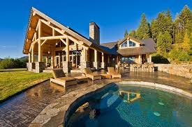 beautiful log home with pool