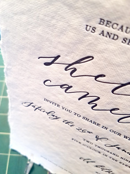 Close up of letterpress calligraphy wedding invitation by shelby nickel designs and inviting letterpress boutique.