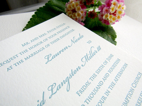 Letterpress wedding invitations in Austin, Texas, shown in blue ink.