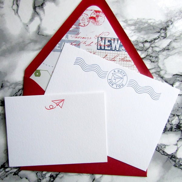 Paper airplane letterpress stationery options by inviting in austin tx.