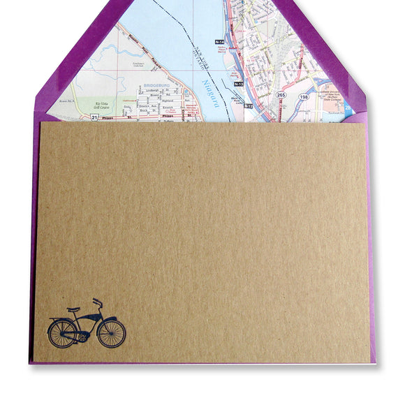 Letterpress bicycle stationery in blue ink on brown cards with lined envelopes.