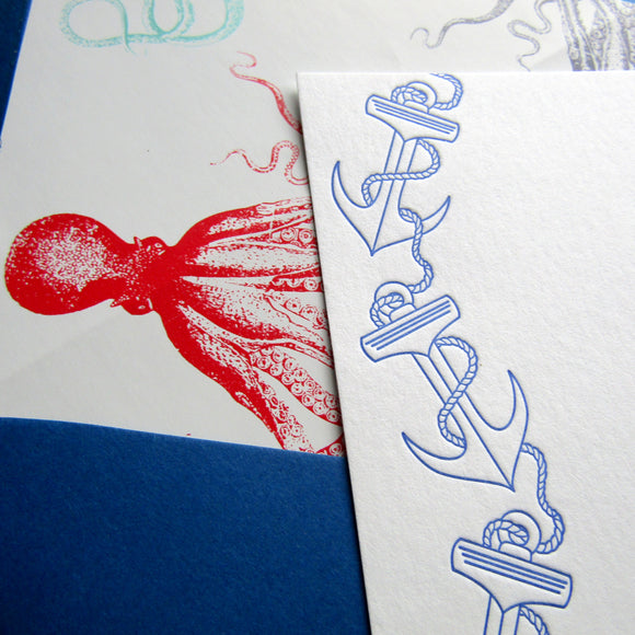Letterpress nautical anchor stationery with octopus-lined envelopes, in blue ink, by inviting letterpress boutique in austin, texas.