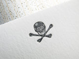 Letterpress skull stationery, printed in gray ink onto white cards. By inviting.