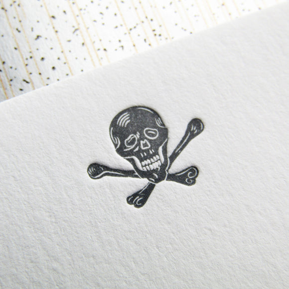 Letterpress skull stationery, printed in gray ink onto white cards, with gray envelopes, lined with speckled papers. By inviting.