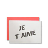 Letterpress Je T'aime valentine card, printed in black ink on white cards with flamingo pink envelopes, by inviting.