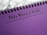Letterpress Weekly Task notepad on pearlized purple cardstock with black wire coil; 26 pages, by inviting in Austin Texas.