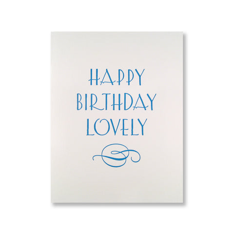 "Letterpress birthday card reads ""Happy Birthday Lovely"" and has an elegant flourish."