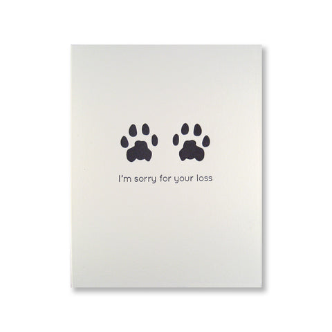 "Letterpress pet sympathy card of cat paw prints and ""I'm sorry for your loss"" printed in black ink."
