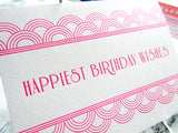 "Letterpress art deco birthday cards that read ""Happiest Birthday Wishes"" in neon pink ink with shimmer aqua envelopes, by inviting in Austin, Texas."
